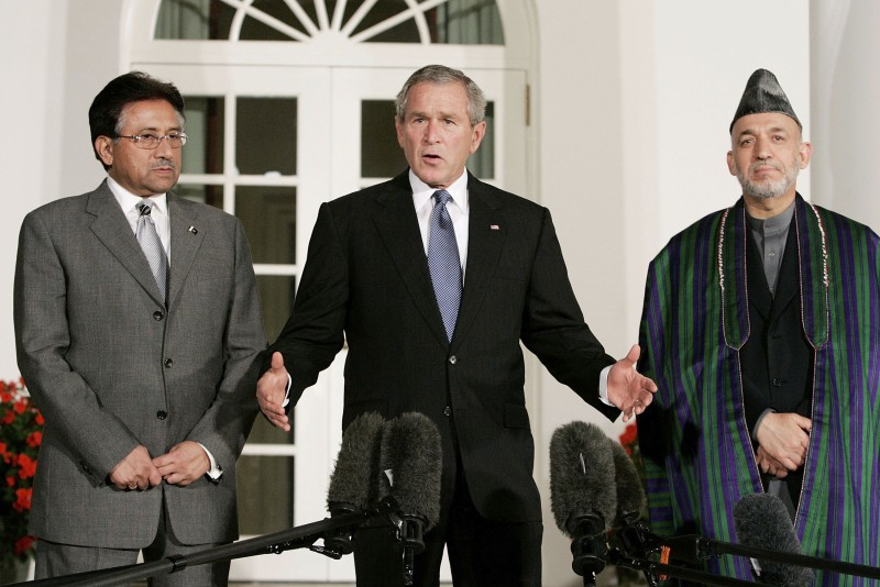 President George W. Bush deliver remarks while flanked by Afghanistan President Hamid Karzai and Pakistani President Pervez Musharraf in the Rose Garden at the White House September 27, 2006 in Washington, DC.