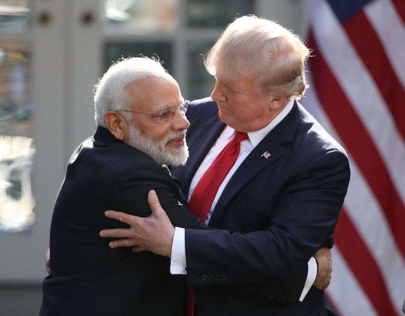 U.S. President Donald Trump and Indian Prime Minister Narendra Modi embrace while delivering joint statements in the Rose Garden of the White House on June 26, 2017.