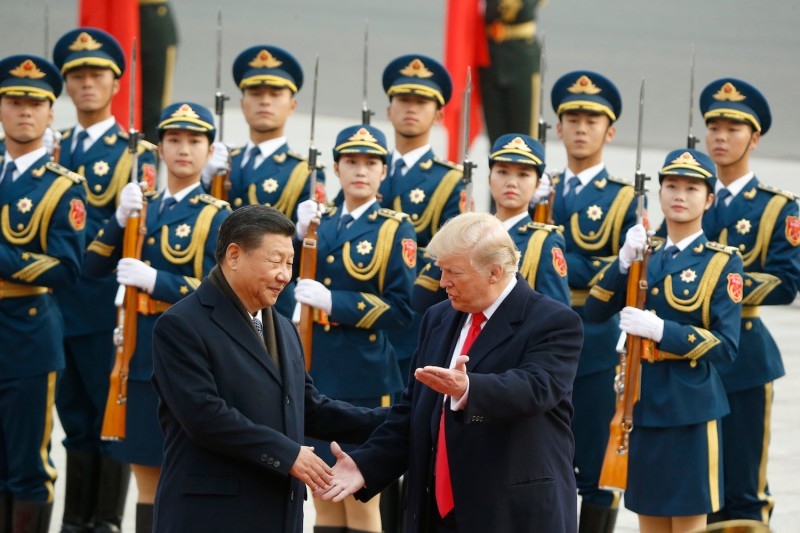 Chinese President Xi Jinping greets U.S. President Donald Trump at a welcome ceremony in Beijing on Nov. 9, 2017.
