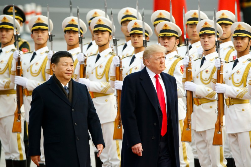 U.S. President Donald Trump takes part in a welcoming ceremony with China's President Xi Jinping on November 9, 2017 in Beijing, China.