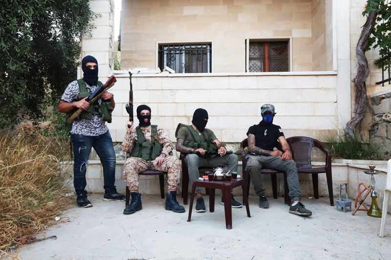 A group of Hezbollah infantry fighters take a break near the group's military base in Hermel, Lebanon, on Aug. 31