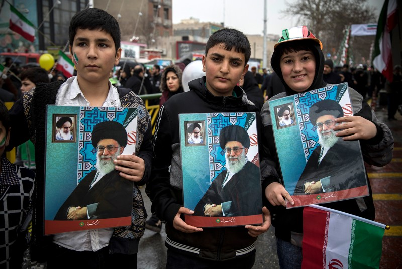 Iranian youth march with portraits of the country's Supreme Leader Ali Khamenei during a ceremony celebrating the 40th anniversary of the Islamic Revolution in Tehran on Feb. 11. Rouzbeh Fouladi/NurPhoto via Getty Images