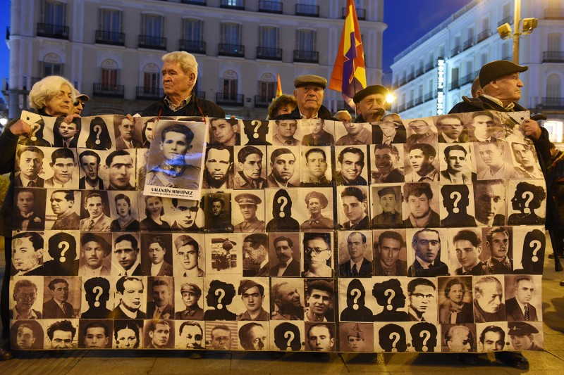 Spaniards display a banner with pictures of people who went missing during the dictatorship of Francisco Franco as they take part in a protest in Madrid on Feb. 14.