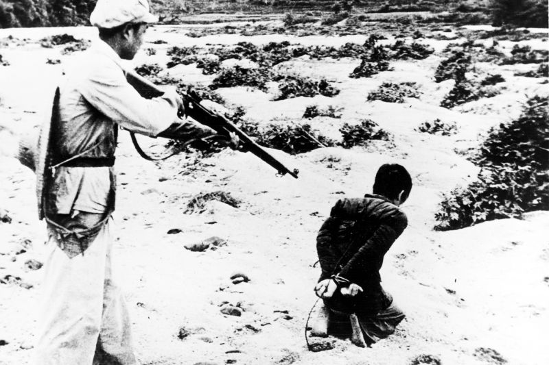 A landlord is executed near Fukang, Xinjiang, circa 1949.