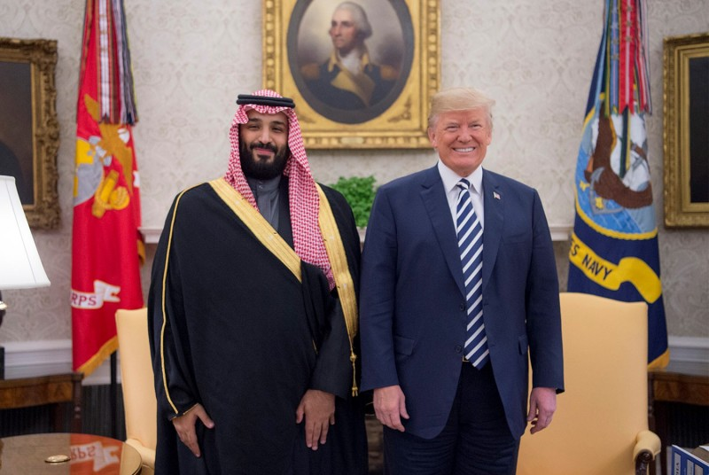U.S. President Donald Trump poses with Saudi Crown Prince Mohammed bin Salman at the White House on March 20, 2018.