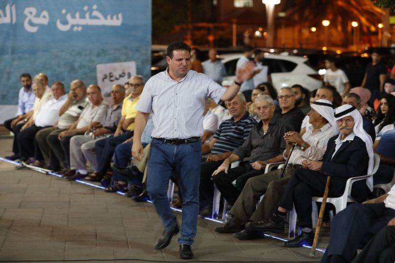 The head of the Joint List alliance, Ayman Odeh, gestures to supporters during an electoral campaign rally in the northern Arab-Israeli town of Sakhnin on Sept. 15, two days before the Israeli general election.