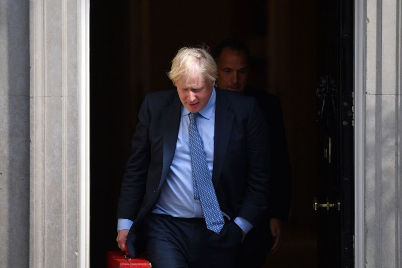 British Prime Minister Boris Johnson leaves 10 Downing Street on September 4, 2019, to take part in his first Prime Minister's Questions at the House of Commons.