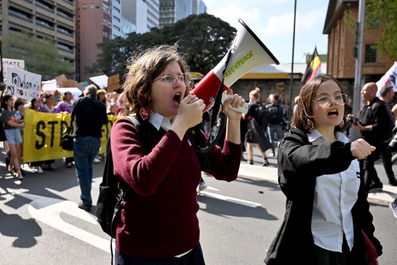 Schoolchildren attend a protest march as part of the worlds largest climate strike in Sydney, Australia on Sept. 20, 2019.