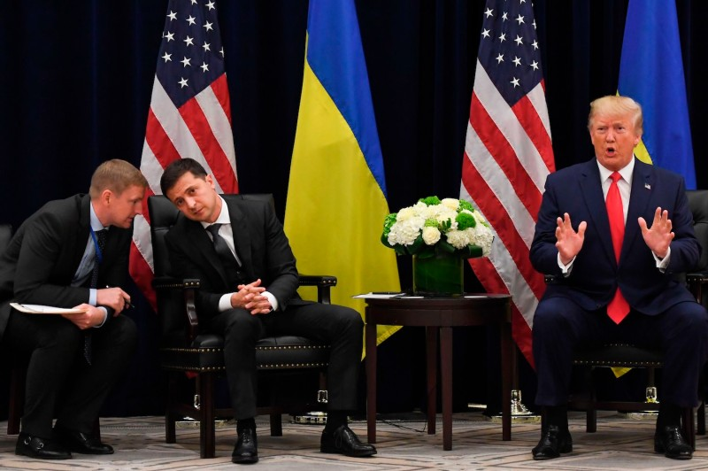 U.S. President Donald Trump speaks as Ukrainian President Volodymyr Zelensky speaks with an aide during a meeting on the sidelines of the United Nations General Assembly in New York on Sept. 25.