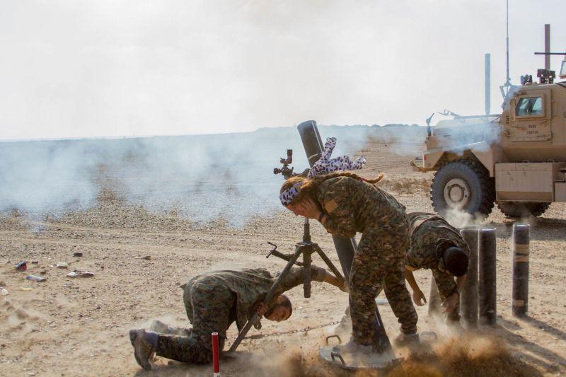 A Syrian Democratic Forces mortar team targets the Islamic State near Deir Ezzor, Syria.