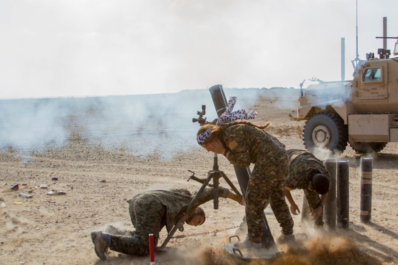 A Syrian Democratic Forces mortar team targets the Islamic State near Deir Ezzor, Syria.