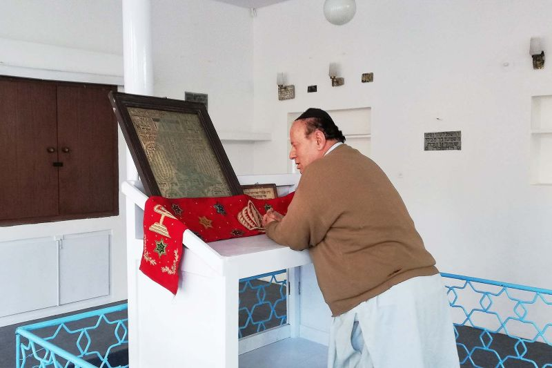 Zabulon Simentov recites from an old Torah scripture in the last synagogue in Kabul.