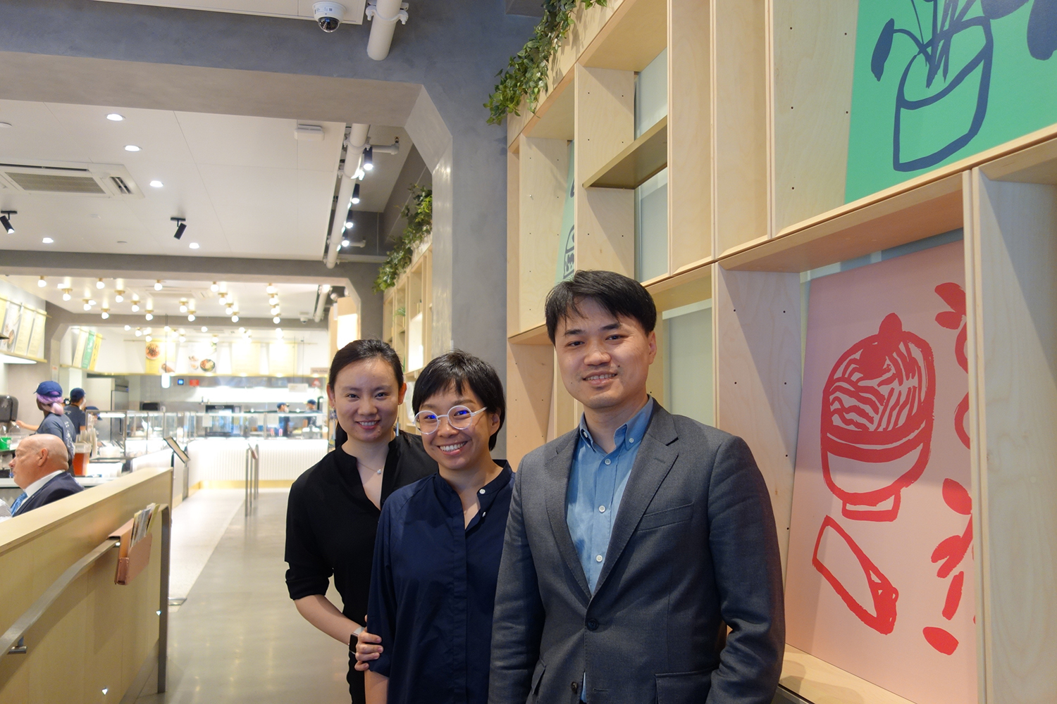 Yong Zhao, Ming Bai, and Wanting Zhang, the founders of Junzi Kitchen, at Junzi's Times Square store on May 22.