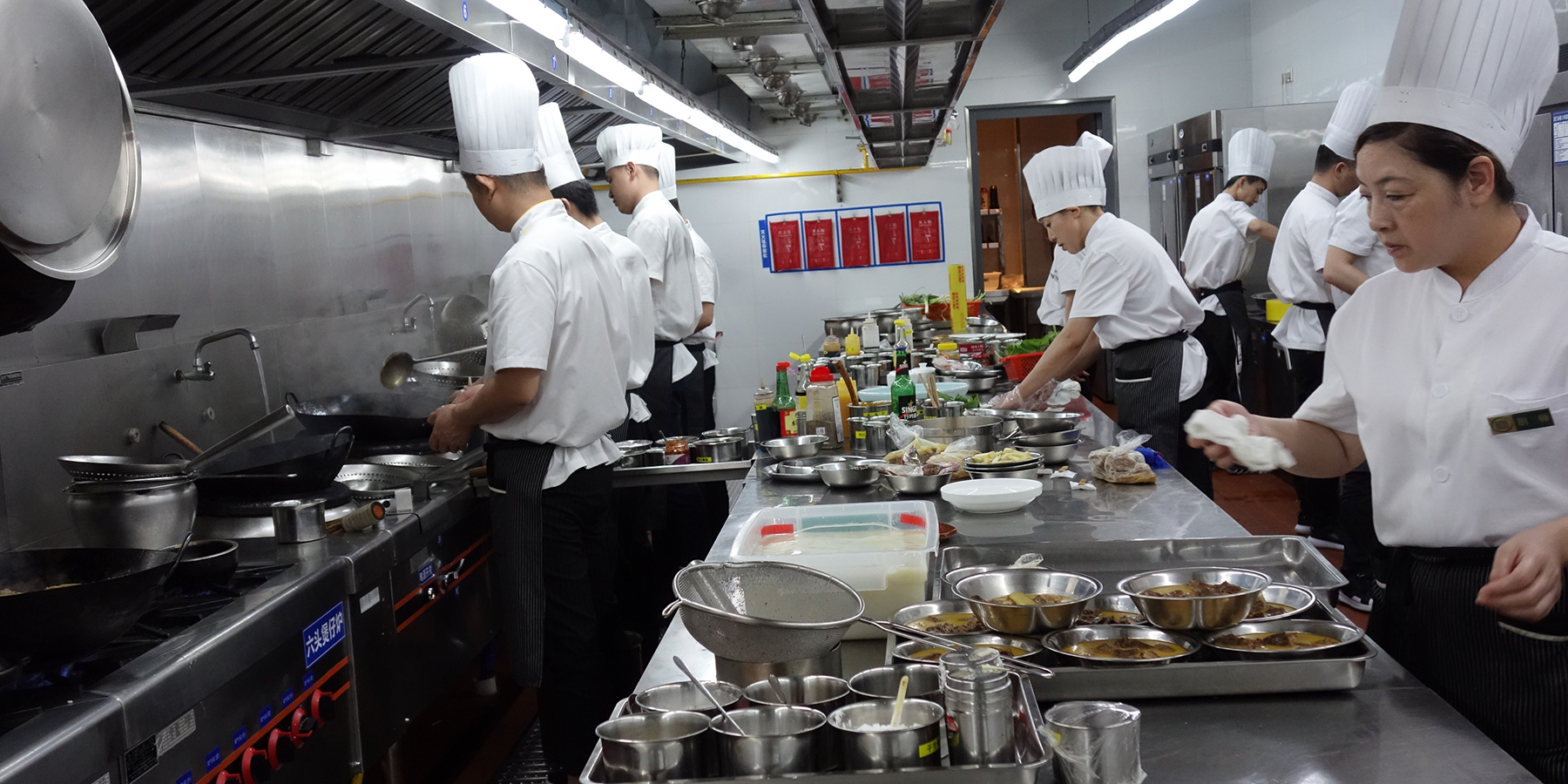 The kitchen at one of the Zhong family restaurants in Wuhan, China, on June 21.