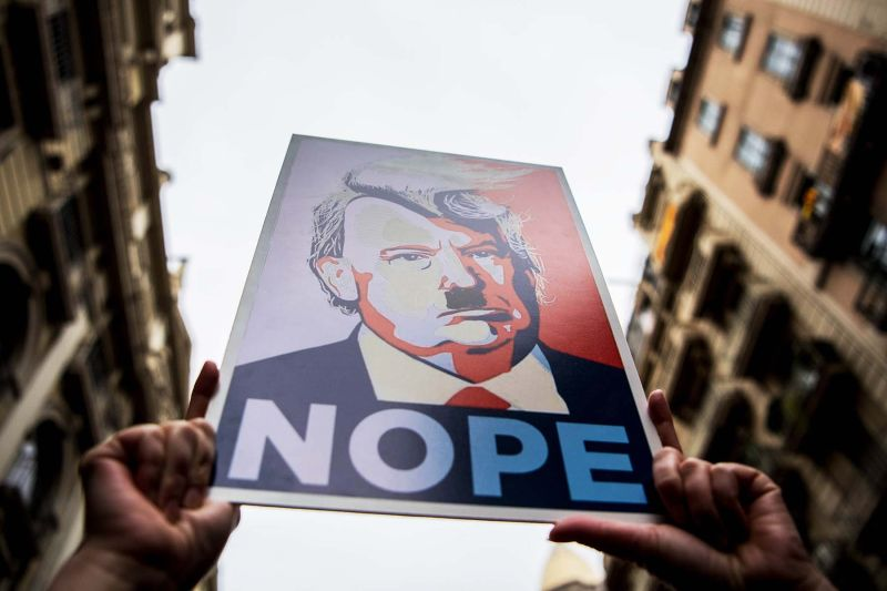 Demonstrators hold posters of U.S. President Donald Trump depicted as Adolf Hitler during the Women's March in Barcelona on Jan. 21.