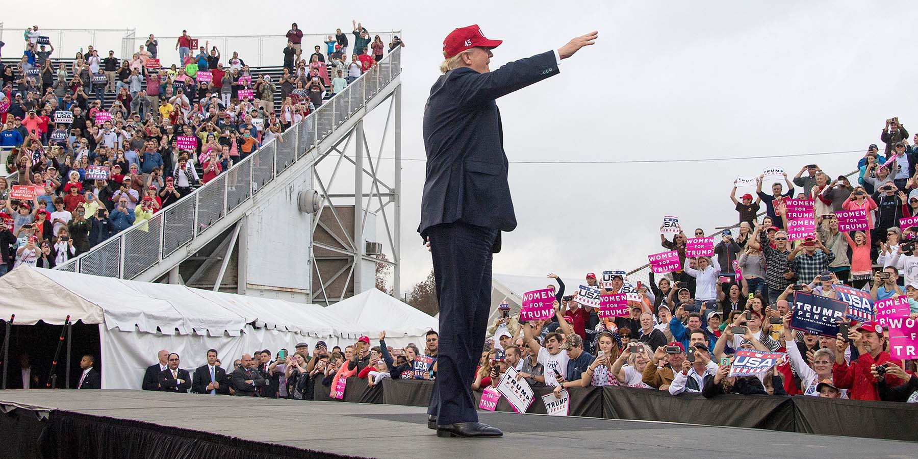Then U.S. President-elect Donald Trump waves to supporters in Mobile, Alabama, on Dec. 17, 2016.