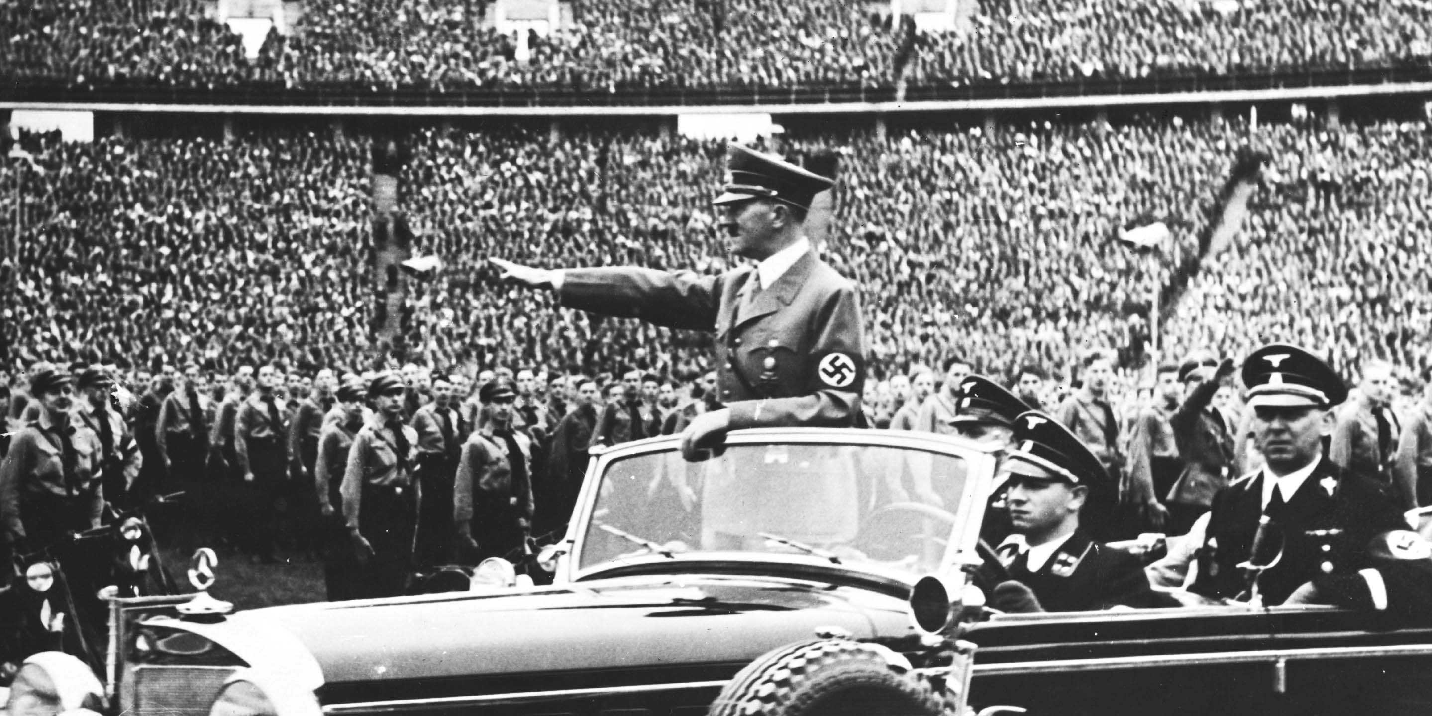 Adolf Hitler salutes a crowd of soldiers at a rally in Germany on May 1, 1938.