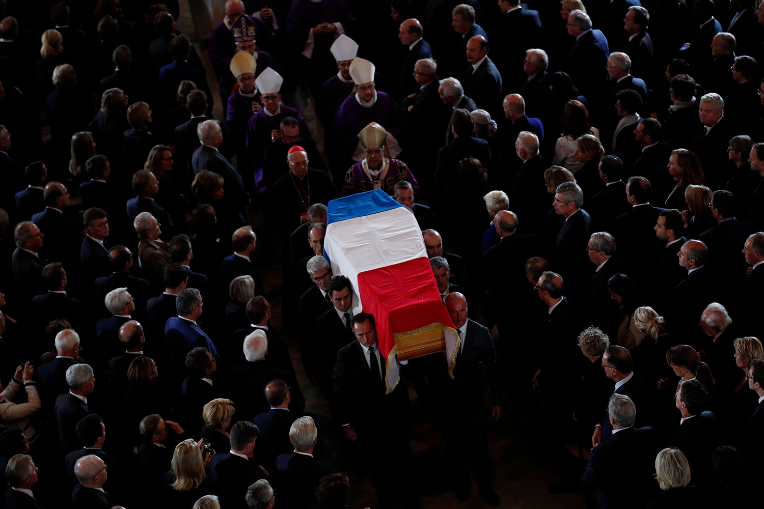 The coffin of the late French president Jacques Chirac is carried from the Saint Sulpice Church in Paris following his funeral service on Sept. 30. FRANCOIS MORI/AFP/Getty Images