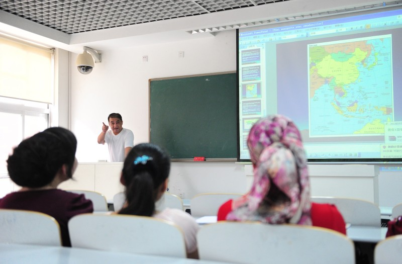 Ilham Tohti lectures in a classroom in Beijing on June 12, 2010.