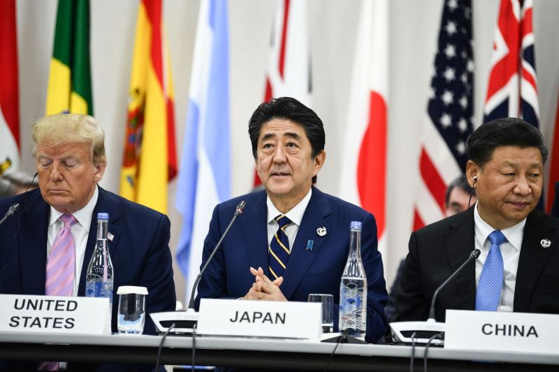 U.S. President Donald Trump (from left), Japan's Prime Minister Shinzo Abe, and China's President Xi Jinping attend a meeting at the G-20 summit in Osaka, Japan.