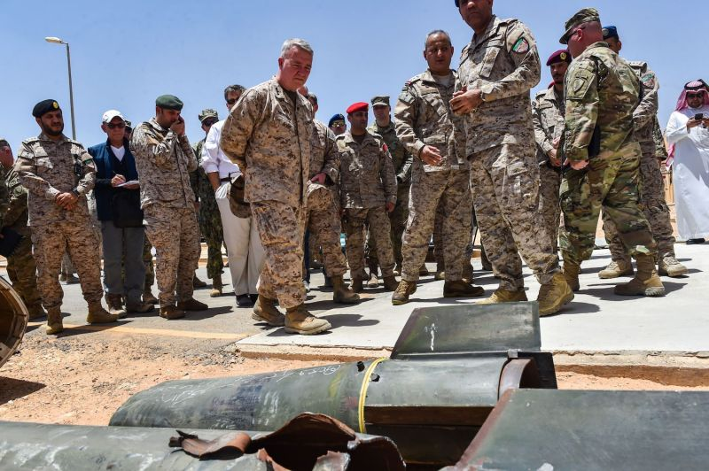 U.S. Marine Corps Gen. Kenneth F. McKenzie Jr., the head of U.S. Central Command, and Lt. Gen. Fahd bin Turki bin Abdulaziz Al Saud, the commander of the Saudi-led coalition forces in Yemen, are shown reportedly Iranian weapons seized by Saudi forces in central Saudi Arabia on July 18.