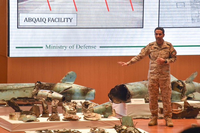 Saudi Defense Ministry spokesman Turki bin Saleh al-Malki displays materials recovered from an attack targetting a Saudi Aramco facility during a press conference in Riyadh on Sept. 18.