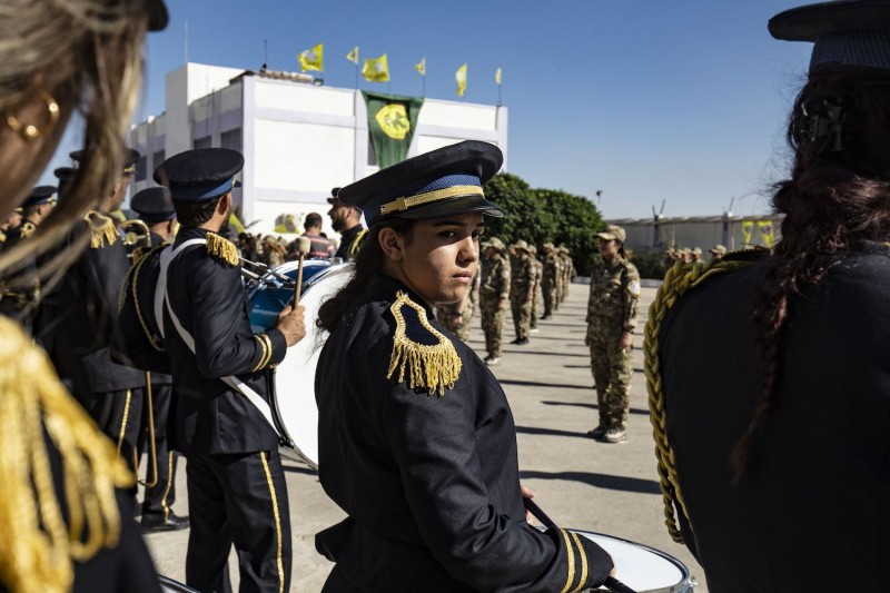 Female fighters of the Syrian Democratic Forces attend a graduation ceremony.