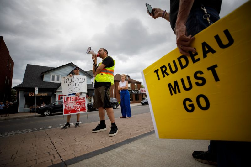 Protestors demonstrate against a campaign visit by Canadian Prime Minister Justin Trudeau in Stoney Creek, Ontario, on Sept. 29.