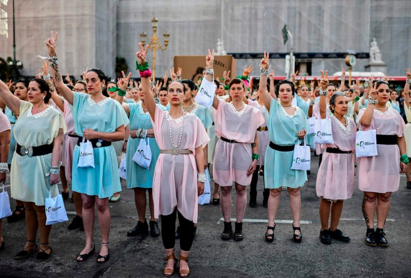Women dressed like the former actress and first lady Eva Perón march to celebrate the anniversary of women's suffrage and denounce the policies of Mauricio Macri's government in Buenos Aires on Sept. 23.