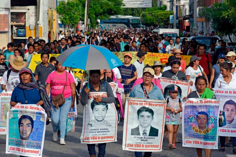 Missing Ayotzinapa students' parents march on the fifth anniversary of their disappearance in Iguala, Mexico.