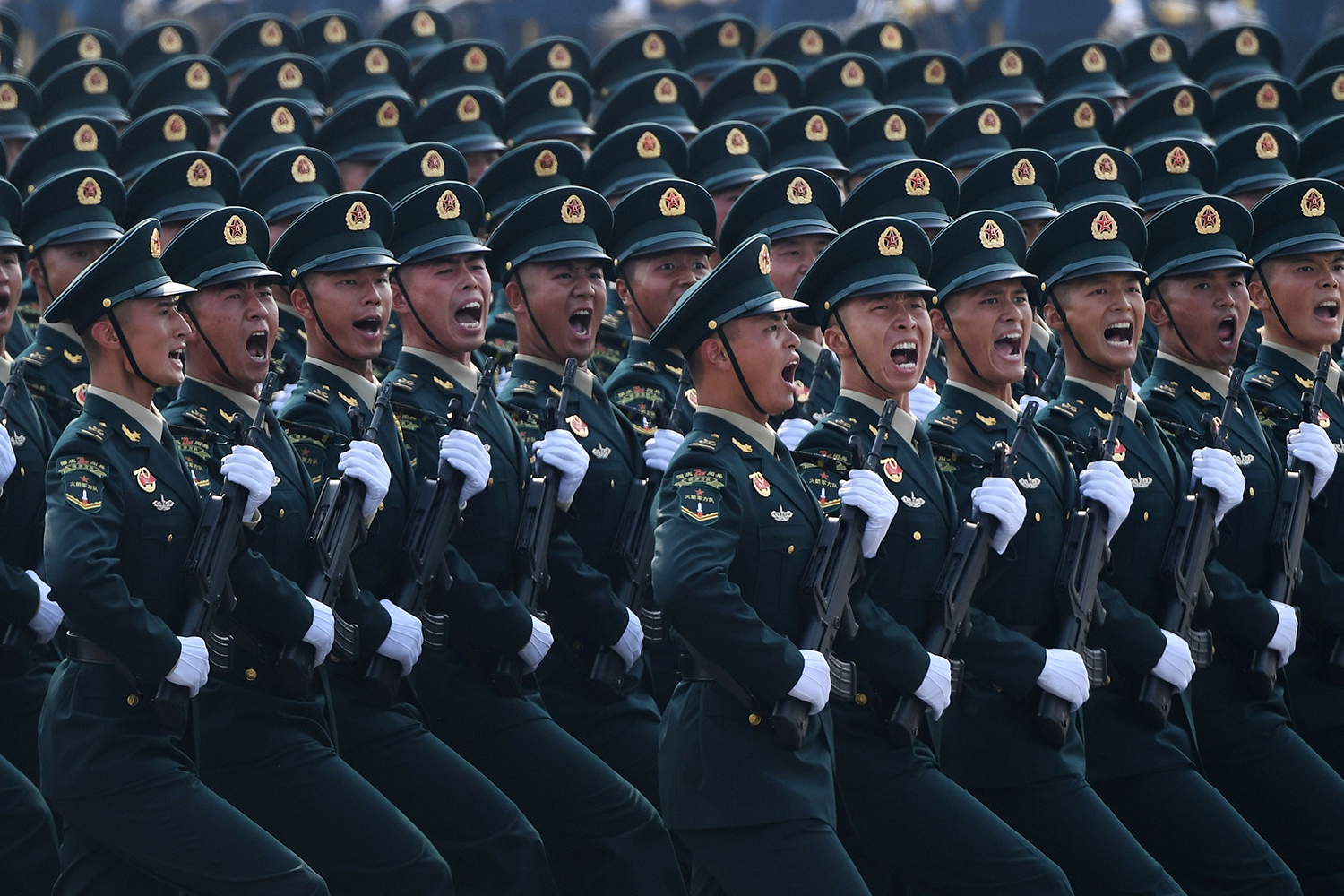 Chinese troops march during a military parade in Tiananmen Square in Beijing to mark the 70th anniversary of the founding of the People's Republic of China on Oct. 1. GREG BAKER/AFP/Getty Images