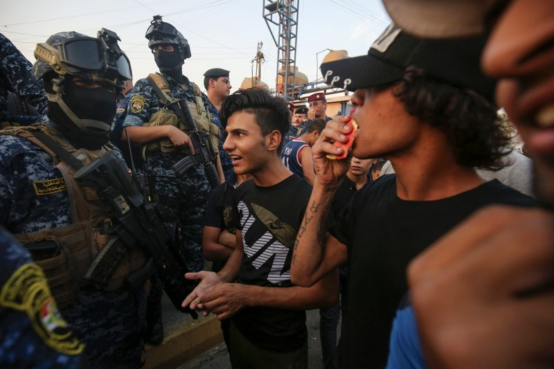 Iraqi protesters speak to police