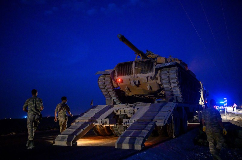 A Turkish army tank on its way to the Syrian border.
