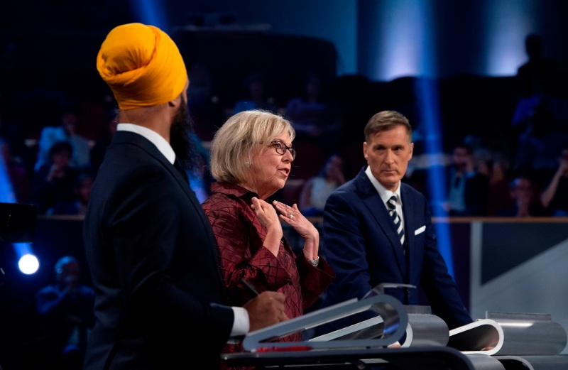 New Democratic Partyleader Jagmeet Singh (from left), Green Party leader Elizabeth May, and People's Party of Canada leader Maxime Bernier take part in a French-language debate at the Canadian Museum of History in Gatineau, Quebec, on Oct. 10.