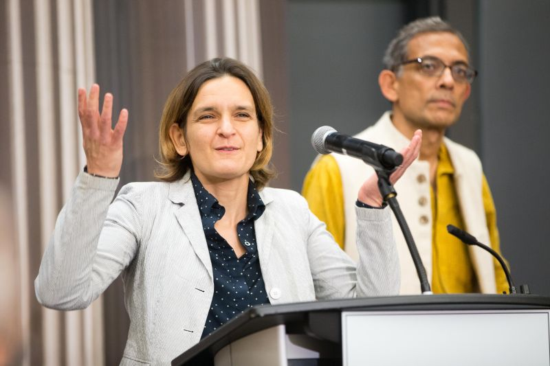 Esther Duflo and Abhijit Banerjee, who share a 2019 Nobel Memorial Prize in Economic Sciences with Michael Kremer, answer questions during a press conference at the Massachusetts Institute of Technology in Cambridge on Oct. 14.