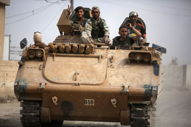 Turkish-backed Syrian fighters drive into northern Syria.