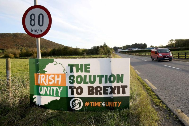 Motorists pass an anti-Brexit Irish Unity banner as they drive in Dundalk, Ireland on Oct. 16, 2019.