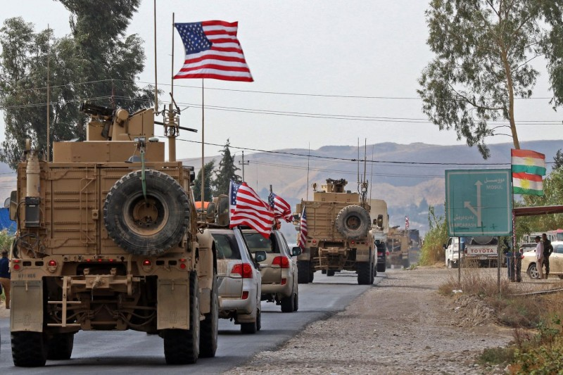 A convoy of U.S. military vehicles arrives near the Iraqi Kurdish town of Bardarash in the  Dohuk governorate after withdrawing from northern Syria on Oct. 21, 2019.