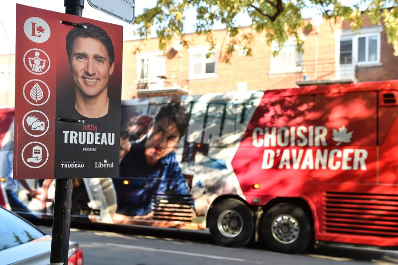 A campaign sign for Canadian Prime Minister Justin Trudeau is posted in front of his campaign bus outside a polling station on election day in Montreal on Oct. 21.