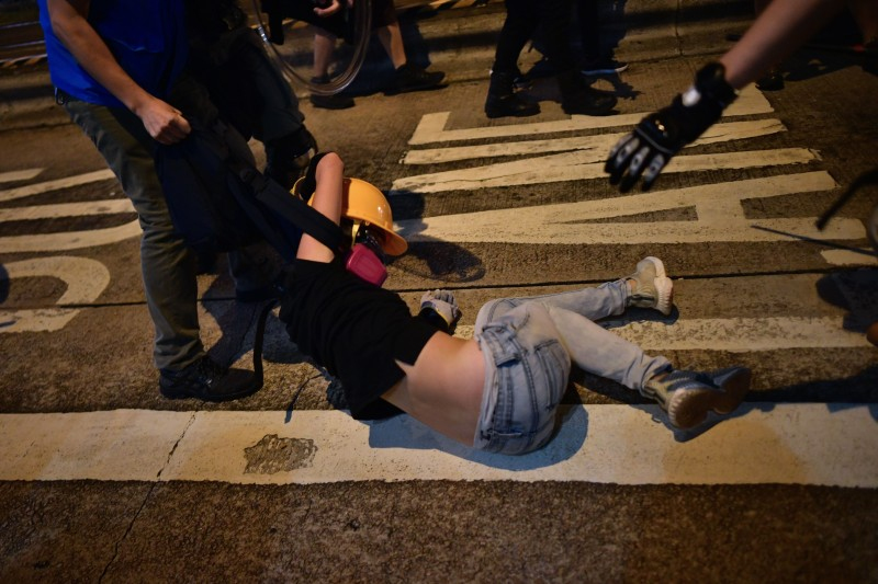 Riot police detain a pro-democracy demonstrator in the Yuen Long district of Hong Kong on Oct. 21.