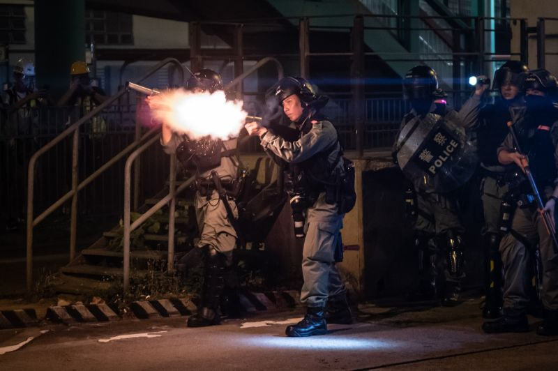 Riot police fire tear gas during a pro-democracy demonstration in the Yuen Long district of Hong Kong on Oct. 21.