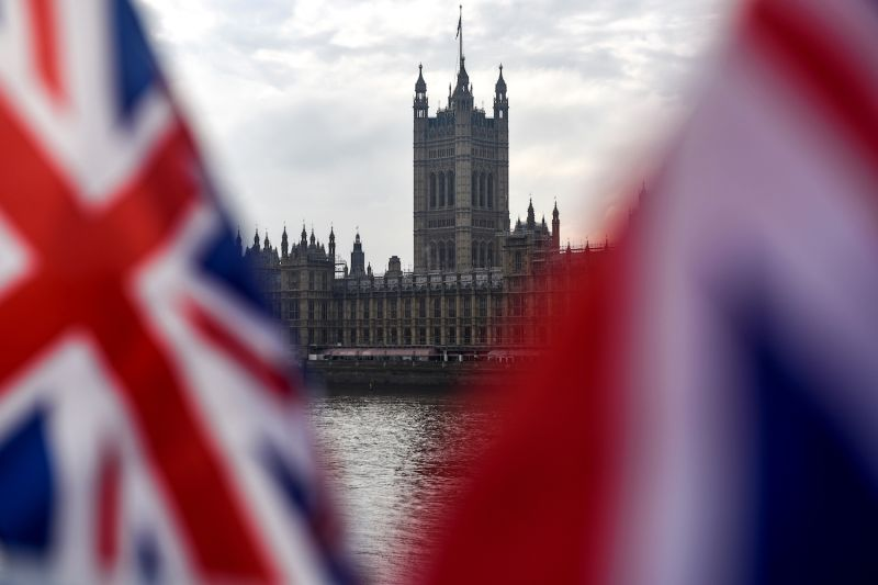 Union Jacks flap in the wind in front of the Houses of Parliament in London on Oct. 23.