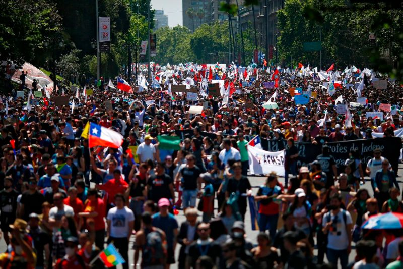 Demonstrators march in Santiago, Chile, on Oct. 23.