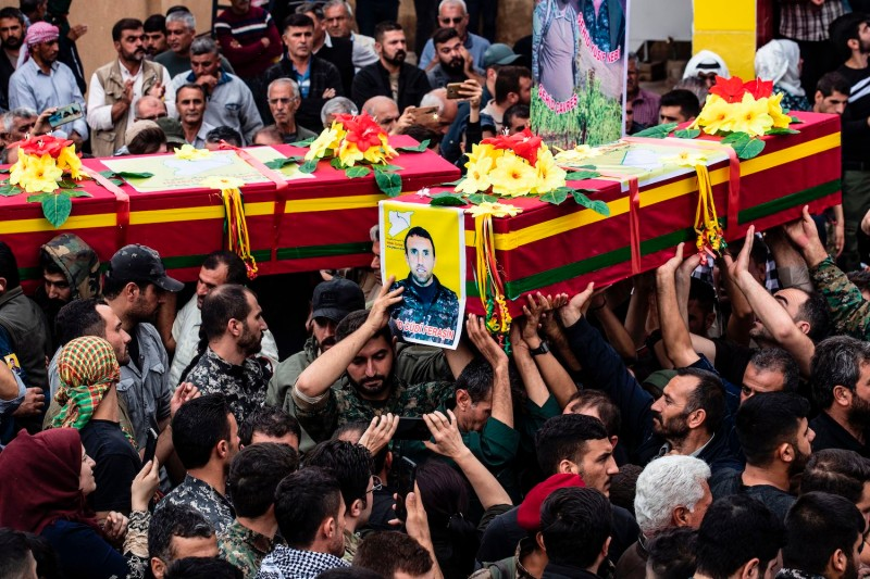 Mourners attend the funeral of three Syrian Democratic Forces fighters killed in battles against Turkey-led forces in the Syrian Kurdish town of Qamishli on Oct. 24.