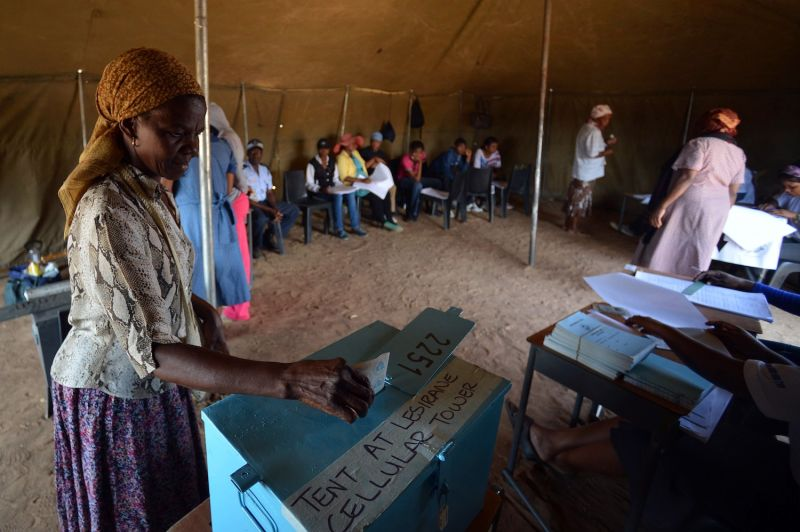 A woman casts her ballot at a polling station in Gaborone, Botswana, on Oct. 24, 2014.