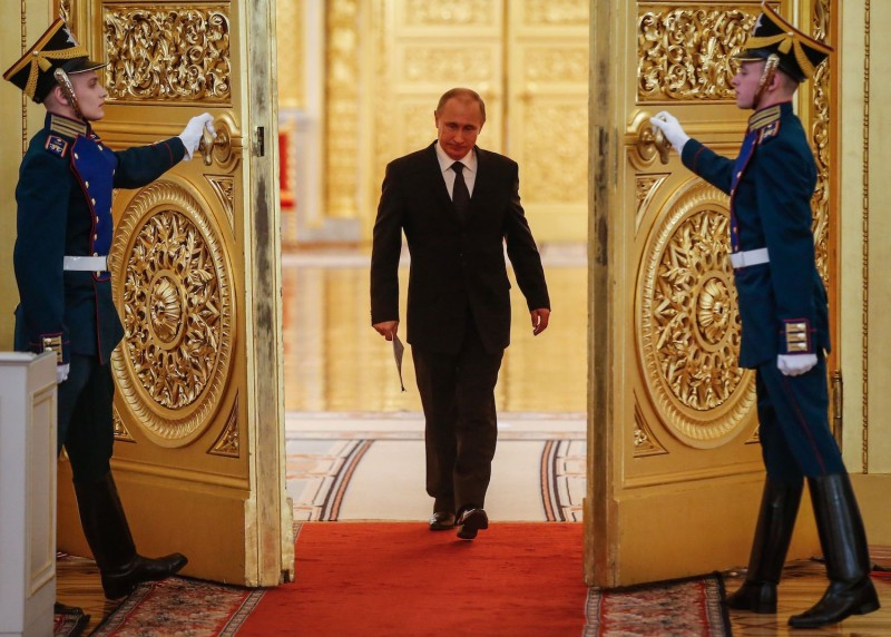 Russian President Vladimir Putin enters a hall before a meeting at the Kremlin in Moscow on March 17, 2015.