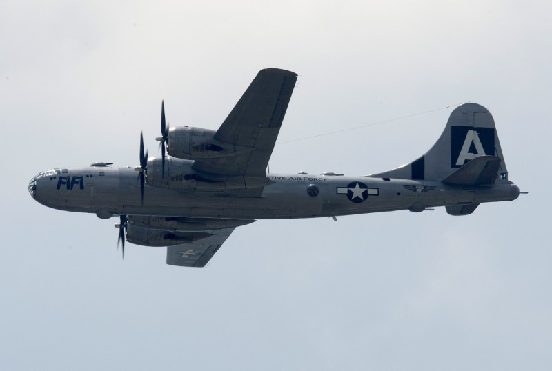 A Boeing B-29 Superfortress flies over the National Mall during the Arsenal of Democracy, a World War II flyover for the 70th anniversary of V-E Day, in Washington on May 8, 2015.
