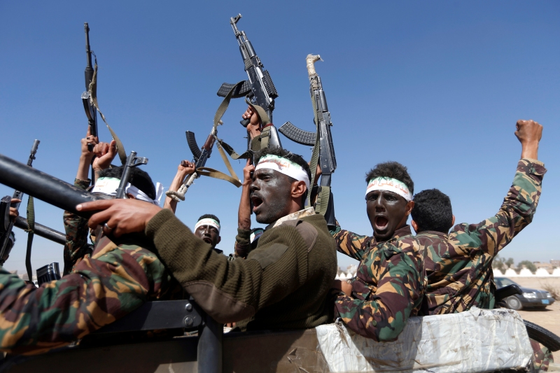 Newly recruited Houthi fighters chant slogans as they ride a military vehicle during a gathering in the capital Sanaa to mobilize more fighters to battlefronts to fight pro-government forces in several Yemeni cities, on January 3, 2017.