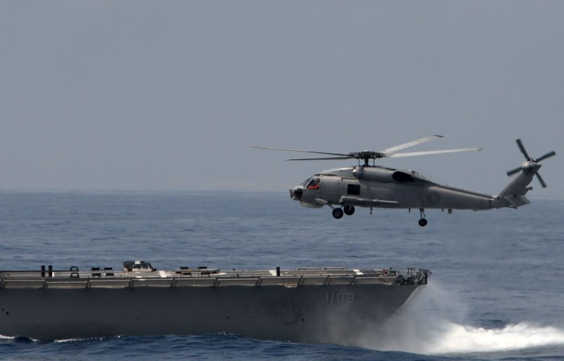 A U.S.-made helicopter takes off from a frigate.