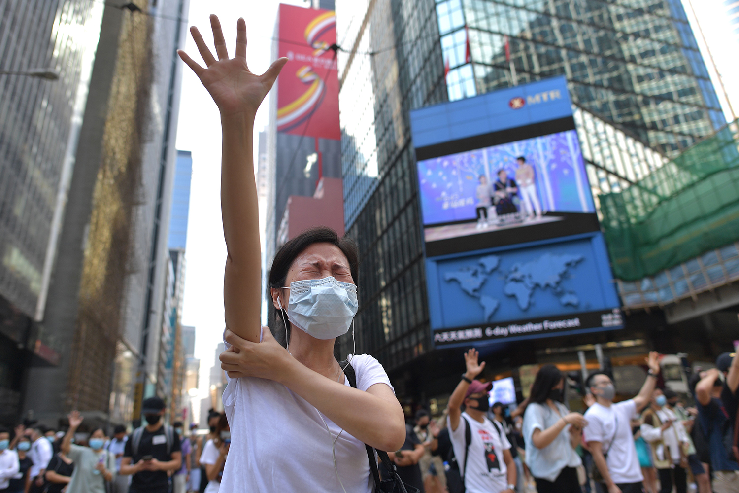 People take part in a march against a potential government ban on protesters wearing face masks in Hong Kong on Oct. 4. NICOLAS ASFOURI/AFP via Getty Images